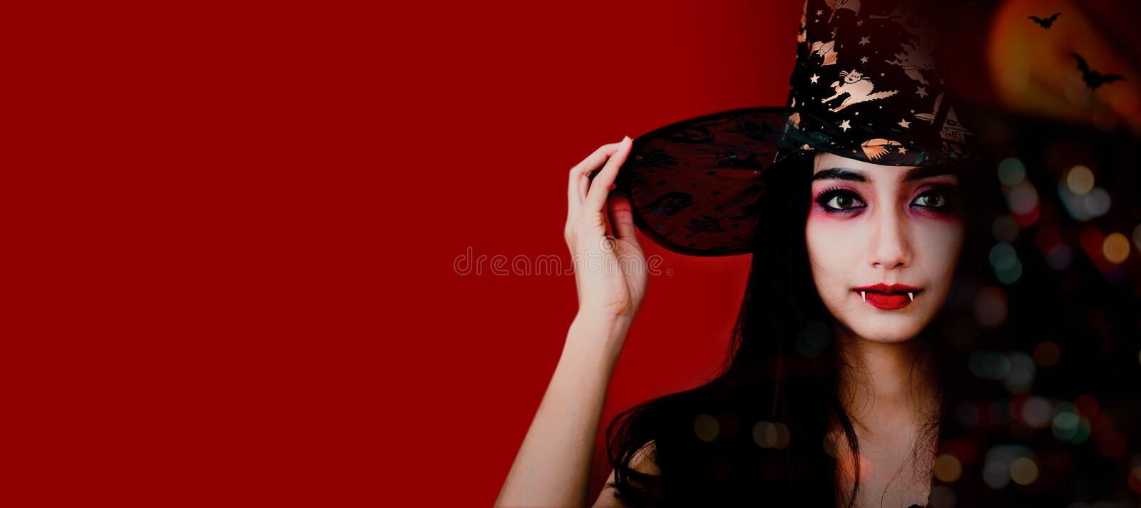 Happy Halloween. Beautiful woman costume. Copy space on dark background stock photography