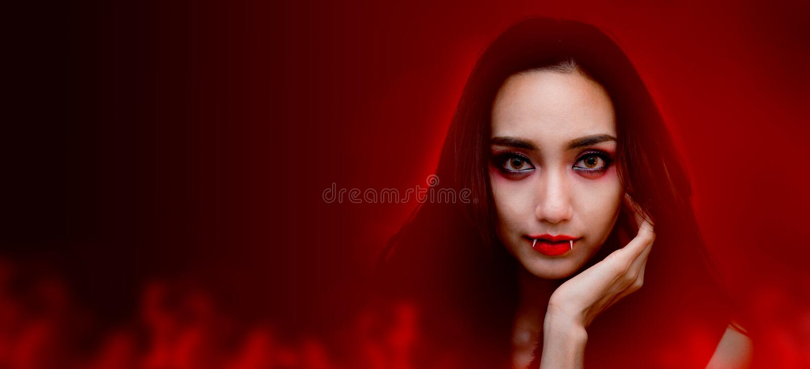 Happy Halloween. Beautiful woman costume and makeup. Copy space for trick or treat in autumn season stock image