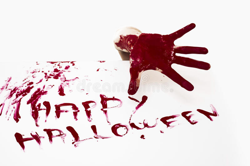 Happy halloween. Bloody hand and Happy halloween written with red human blood on white background stock image