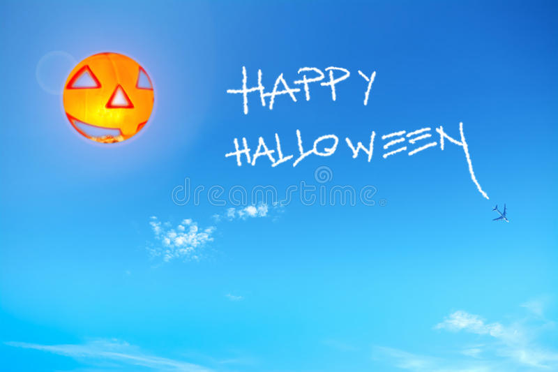 Happy halloween in the blue sky. Happy halloween written in the sky royalty free stock photography