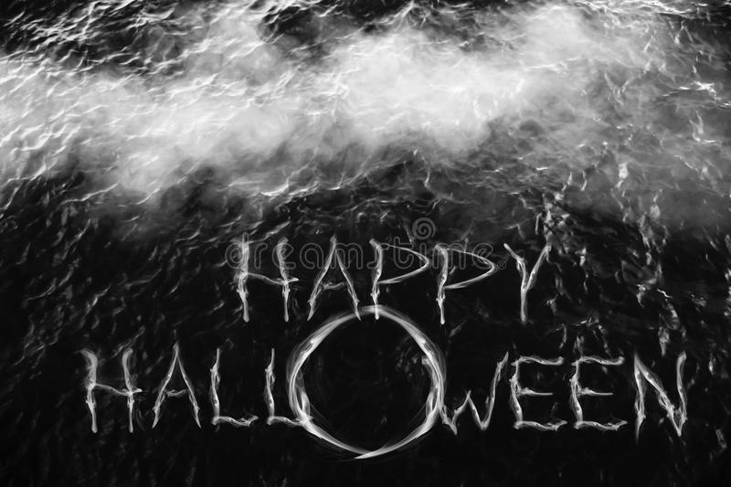 Happy halloween. Happy halloween on blurred dark water with smoke for background stock images