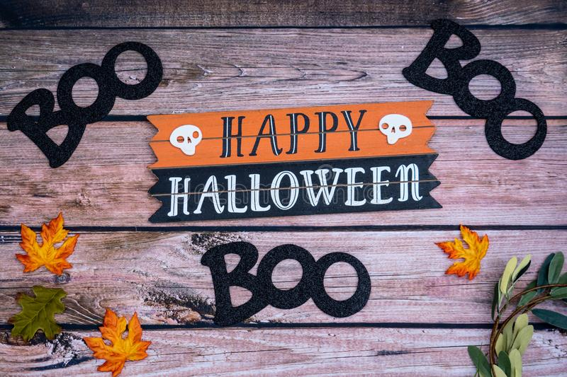 Happy Halloween boo Halloween background on wood backdrop. With pumpkins and maple leaves. Fall and Halloween concept stock images