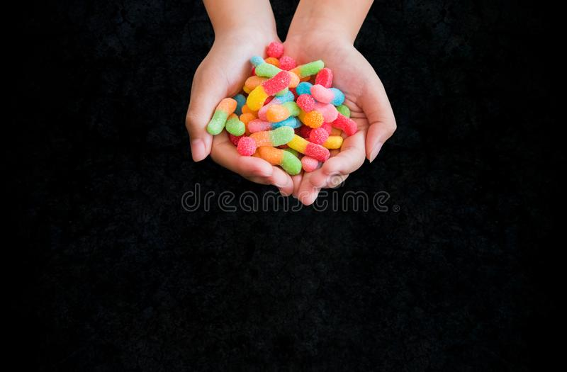 Happy Halloween with candy. On kid hands with black background. trick or treat at in autumn season royalty free stock photography