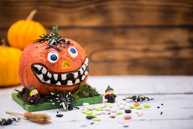 Happy Halloween concept. Happy Halloween with candy and pumpkin for party. trick or treat at in autumn season royalty free stock images