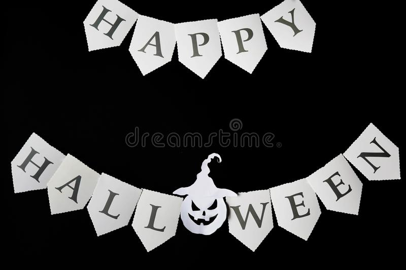 Happy Halloween Card.black background with Halloween pumpkin. Flat lay, copy space.  royalty free stock photography