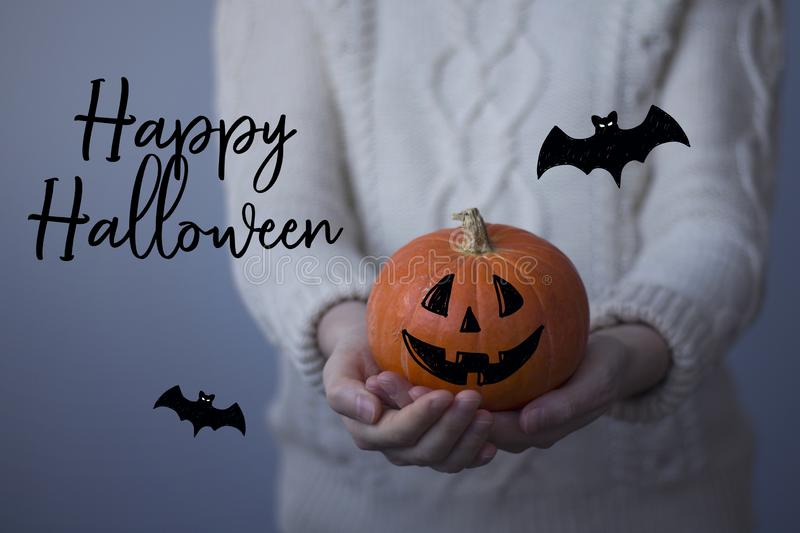 Happy Halloween card with hand drawn doodle illustrations. Woman holds a small halloween pumpkin.  royalty free stock images