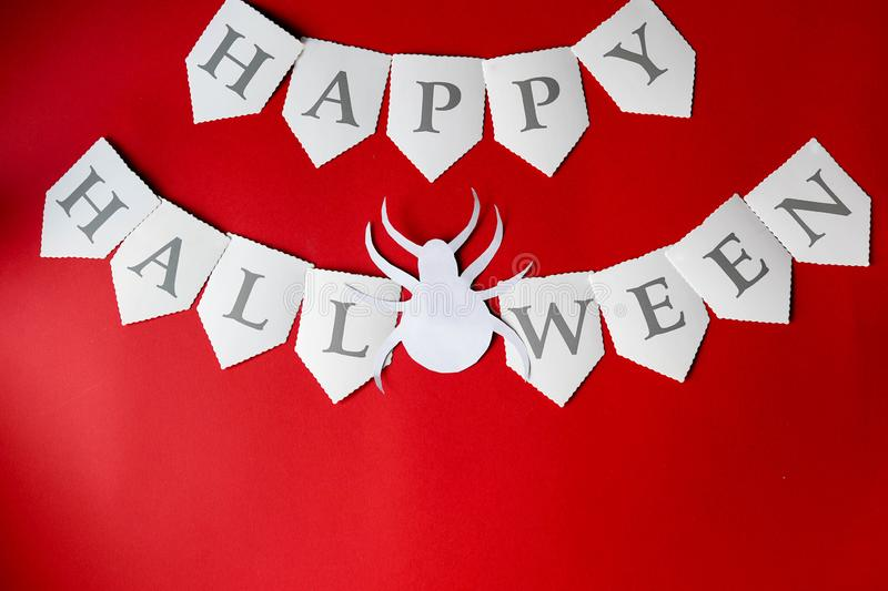 Happy Halloween Card. Stylish red background with Halloween spider. Flat lay, top view.  stock photography