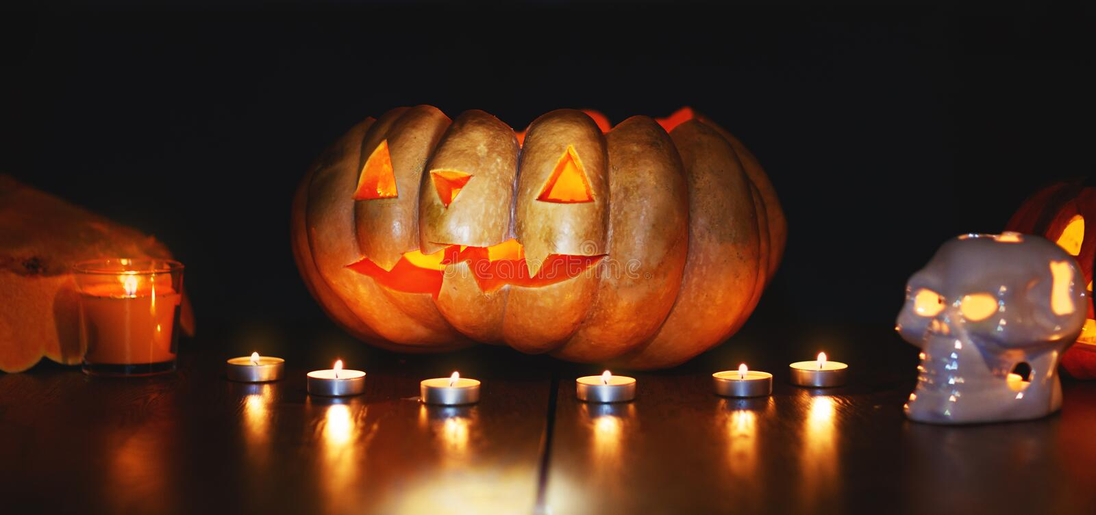 Happy Halloween! a composition of pumpkins and candles in dark. Happy Halloween! a composition of pumpkins and candles in the dark royalty free stock images