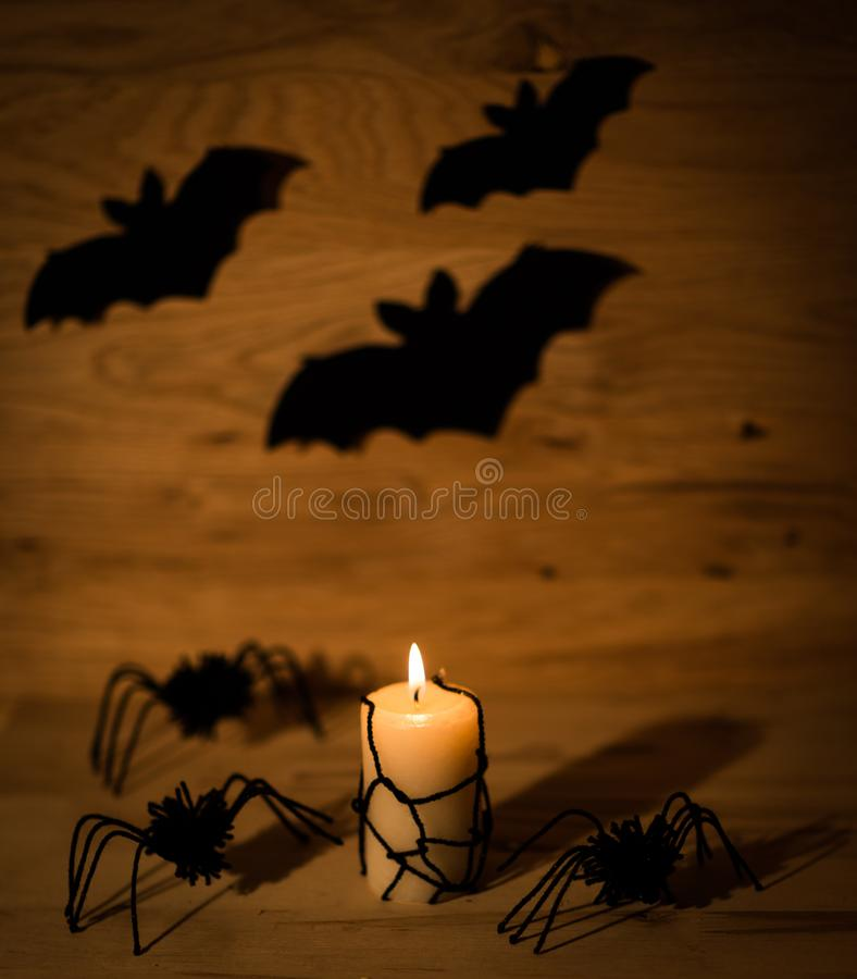 Happy Halloween concept. candle and spiders on a wooden table. Photo with copy space stock images