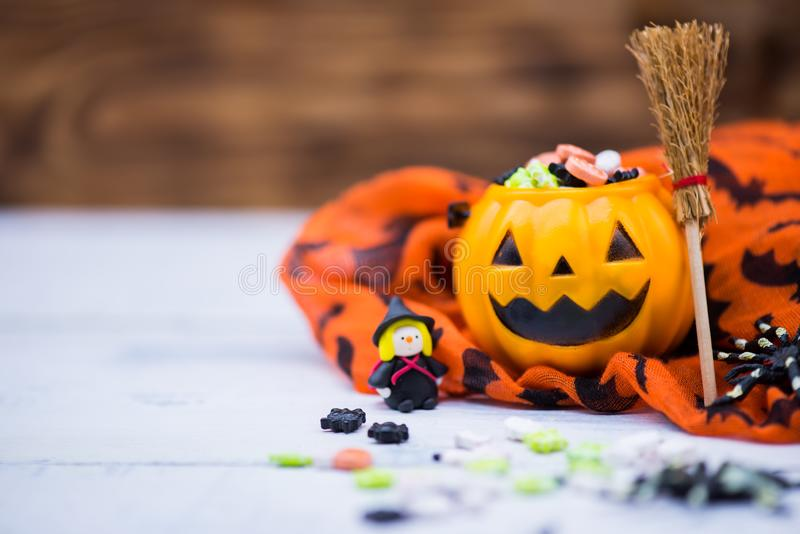 Happy Halloween concept. Happy Halloween with candy and pumpkin for party. trick or treat at in autumn season stock image