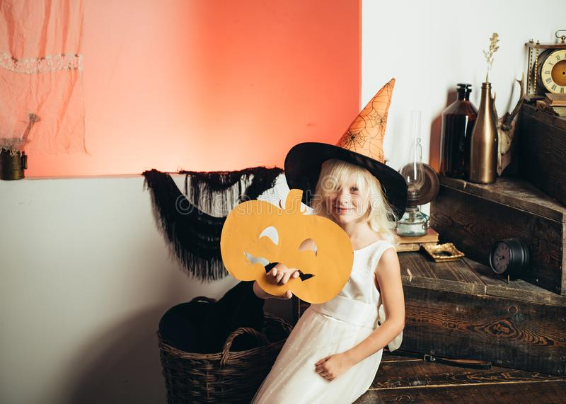 Happy halloween cute girl with pumpkins on a halloween background. Halloween party. Holiday concept. Halloween home. Decoration stock photo