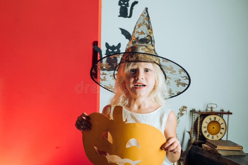 Happy halloween cute girl with pumpkins on a halloween background. Halloween party. Holiday child concept. Halloween. Home decoration royalty free stock photos