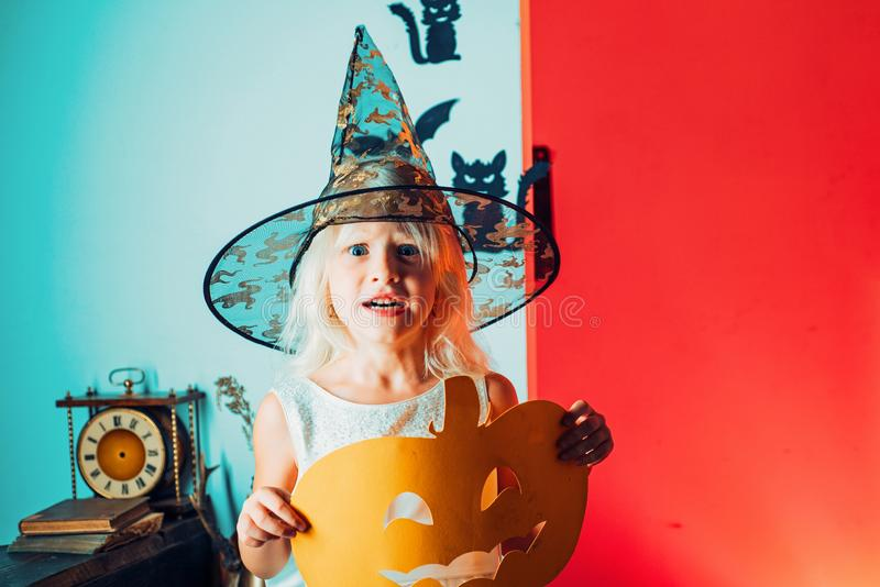 Happy halloween cute girl with pumpkins on a halloween background. Halloween party. Holiday child concept. Halloween. Home decoration royalty free stock images