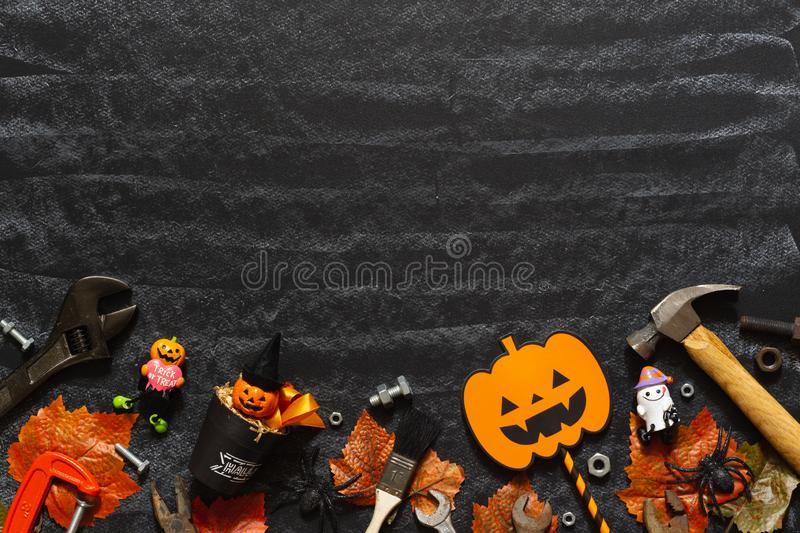 Happy Halloween day with construction DIY handy tools on black chalk board background concept. Flat lay Top view with copy space. For your text, autumn, builder stock photos