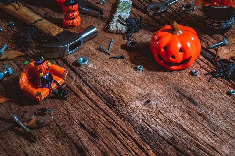 Happy Halloween day with construction DIY handy tools on rusty wooden background concept with copy space. Autumn, backdrop, card, carpenter, celebration royalty free stock photos