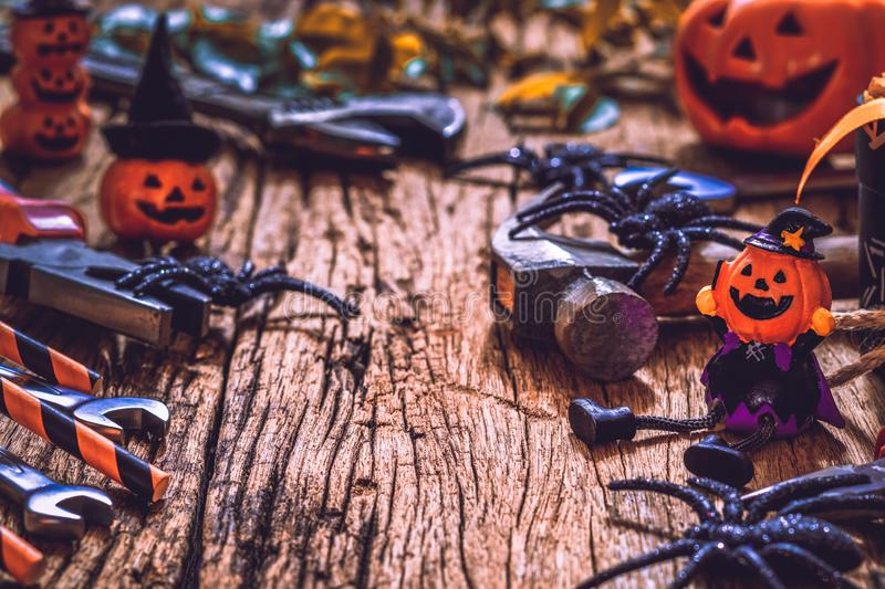 Happy Halloween day with construction DIY handy tools on rusty wooden background concept with copy space. Autumn, backdrop, card, carpenter, celebration royalty free stock photography