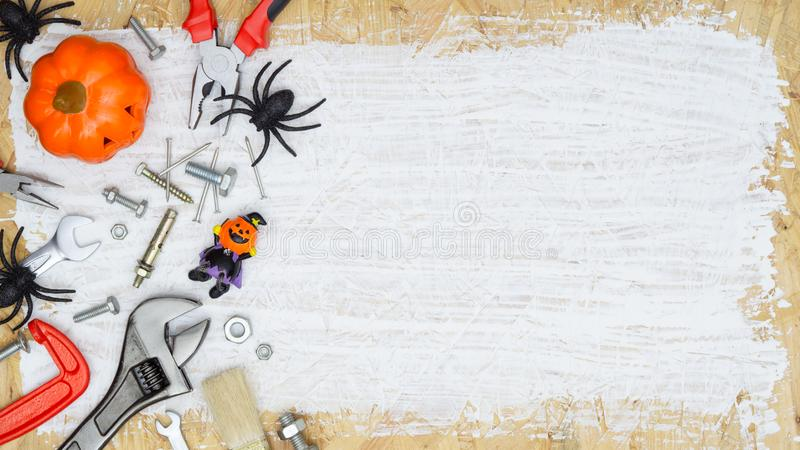 Happy Halloween day with construction handy tools on rusty white painted wood background concept. Top view with copy space. Autumn, backdrop, builder stock photos