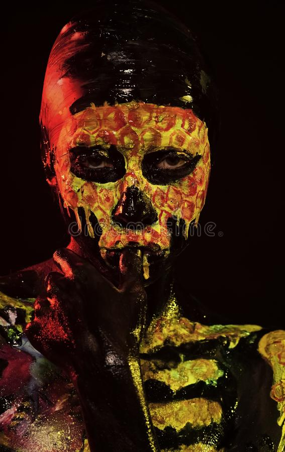Happy Halloween day of dead celebration. Girl with skull face paint on black background. Body painting and art. Life and death concept. Woman skeleton with royalty free stock image