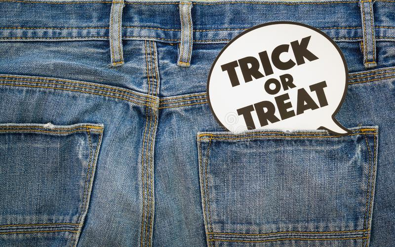 Happy Halloween day. Fashion background concept. Top View of Trick or Treat sign on denim jeans. royalty free stock photos
