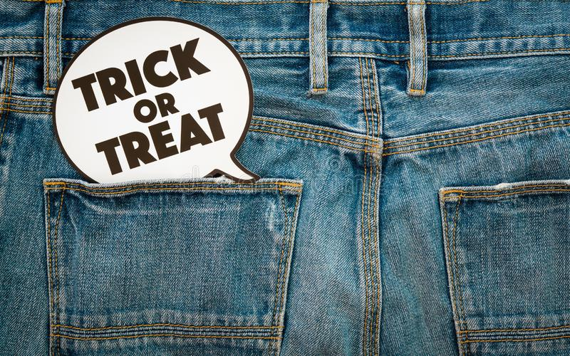 Happy Halloween day. Fashion background concept. Top View of Trick or Treat sign on denim jeans. stock image