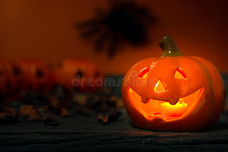 Happy Halloween day. Happy Halloween Scary flaming pumpkins with horrible faces in dark. Lamp and candles are nearby. Spooky Halloween background with jack o royalty free stock photography