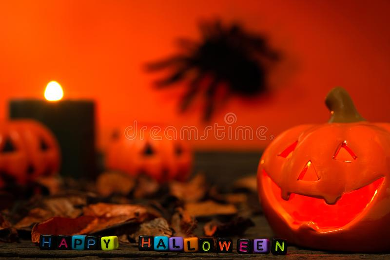 Happy Halloween day. Happy Halloween Scary flaming pumpkins with horrible faces in dark. Lamp and candles are nearby. Spooky Halloween background with jack o stock images
