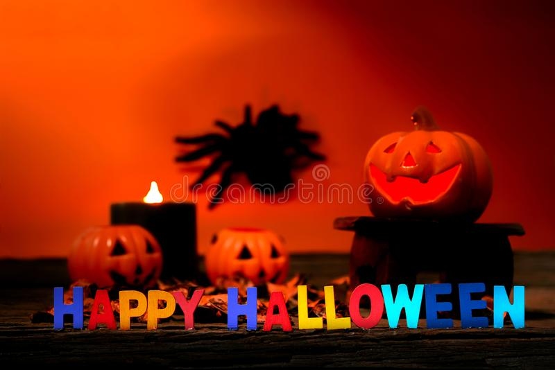 Happy Halloween day. Happy Halloween Scary flaming pumpkins with horrible faces in dark. Lamp and candles are nearby. Spooky Halloween background with jack o royalty free stock photo