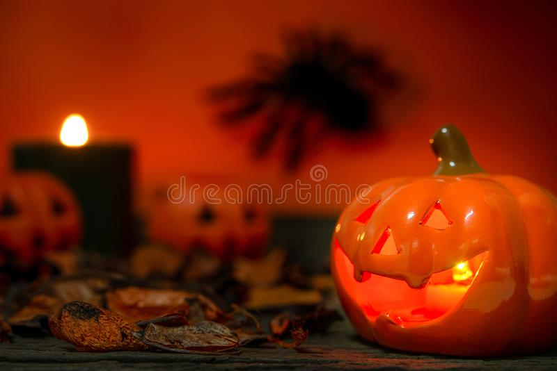 Happy Halloween day. Happy Halloween Scary flaming pumpkins with horrible faces in dark. Lamp and candles are nearby. Spooky Halloween background with jack o royalty free stock photos