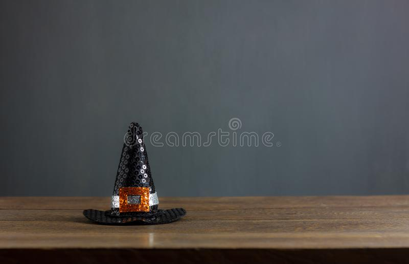 Happy Halloween decorations festival concept background. The hat of witch on modern rustic brown wooden at table home office.free space for creative design text royalty free stock images