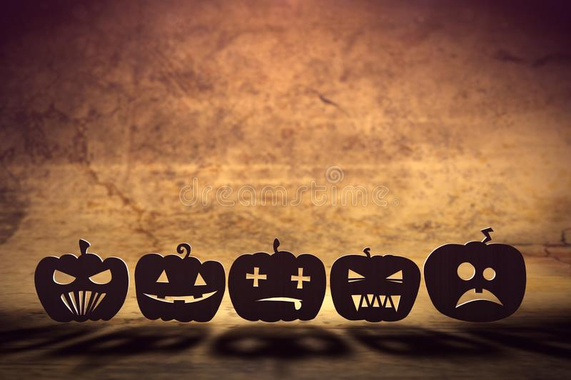 Happy Halloween with emotions. 3D illustration of flat pumpkins with various emotions stock illustration