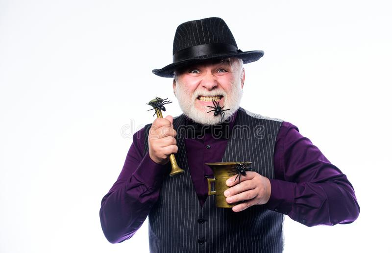Happy halloween. evil wizard cooking magic potion with spider. halloween holiday costume. barman make cocktail for. Halloween party. mature man magician in royalty free stock images