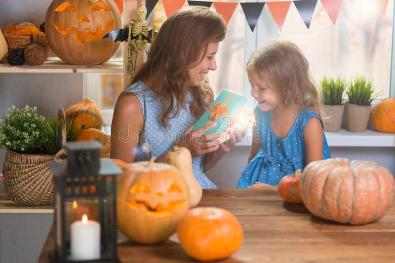 Happy Halloween. Family little beautiful girl with mother celebrating home with pumpkins. Happy Halloween. Family little beautiful girl with mother celebrating stock photo