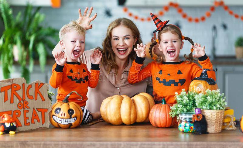 Happy Halloween! family mother and children getting ready for ho. Liday cutting a pumpkin stock images