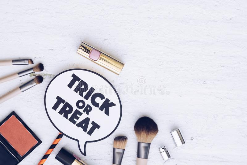 Happy Halloween Festival with cosmetic fashion flat lay concept. stock photo