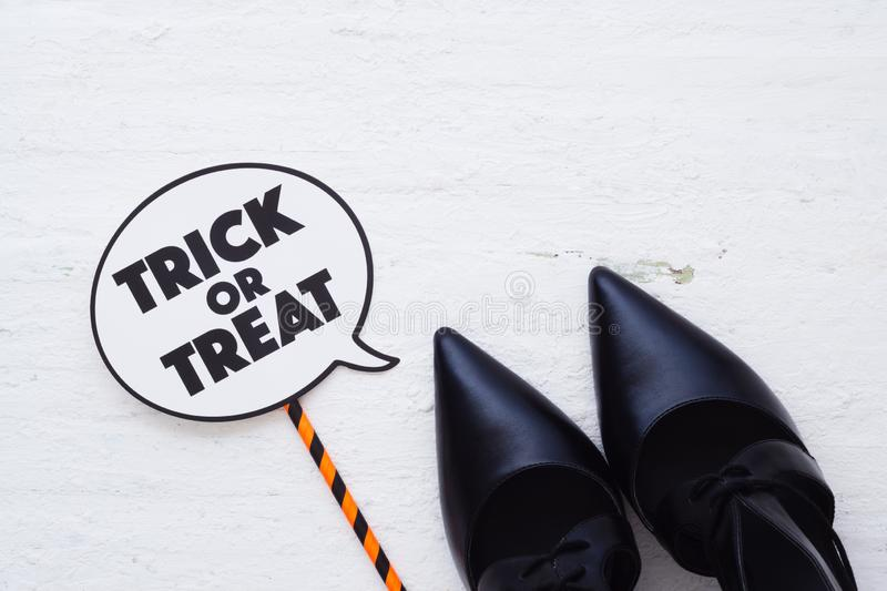 Happy Halloween Festival with female beauty high heels with trick or treat sign, Halloween fashion shopping concept. stock photos