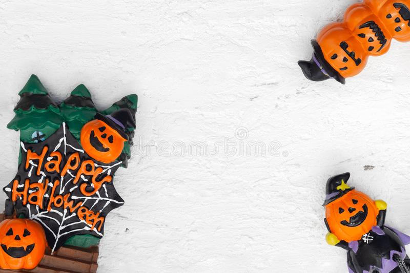 Happy Halloween festival Flat lay top view of Head Doll Pumpkins. Haunted spooky on grunge white wood background. Copy space for your text royalty free stock image