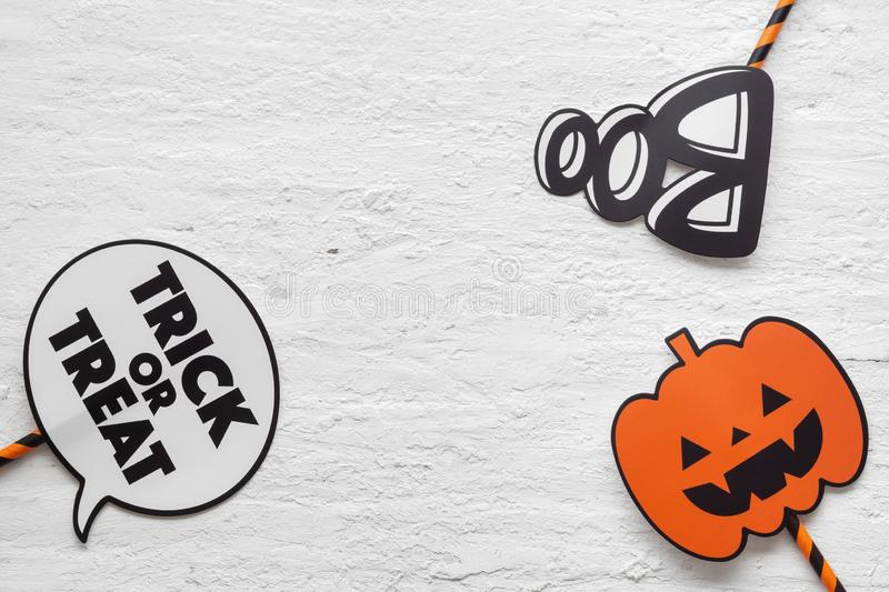 Happy Halloween Festival. Flat lay Top view of Trick or treat,. Boo and head pumpkins haunted spooky sign on grunge white wood background royalty free stock photos