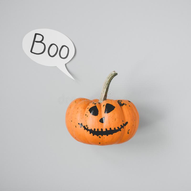 Happy halloween. Funny Jack o Lantern with speech bubble on gray background.  stock photo