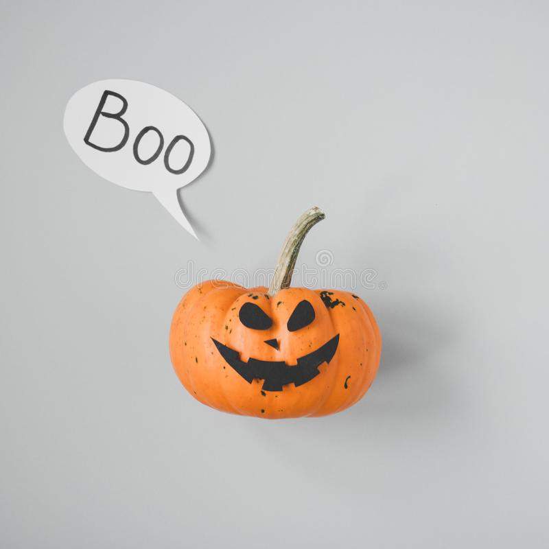 Happy halloween. Funny halloween pumpkin Jack o Lantern on gray background.  stock photos