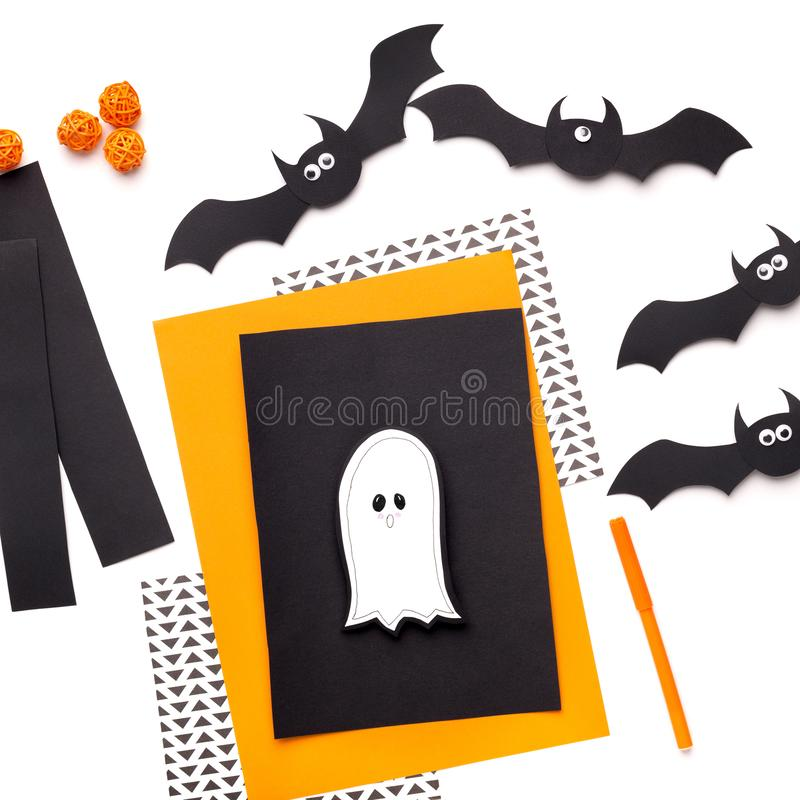 Happy Halloween ghost cut of paper on greeting card stock photos
