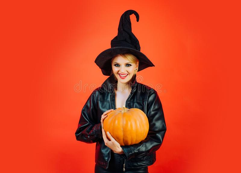 Happy Halloween. Happy gothic young woman in witch halloween costume. Witch posing with Pumpkin. Happy Halloween. Happy gothic young woman in witch halloween stock photos