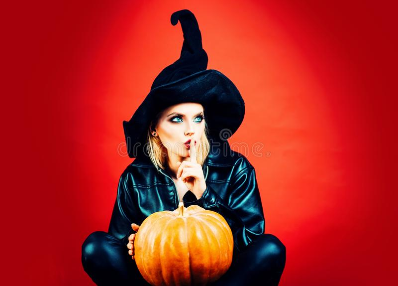 Happy Halloween gothic young woman in witch halloween costume. Secret Halloween. Happy Halloween gothic young woman in witch halloween costume. Secret Halloween stock image