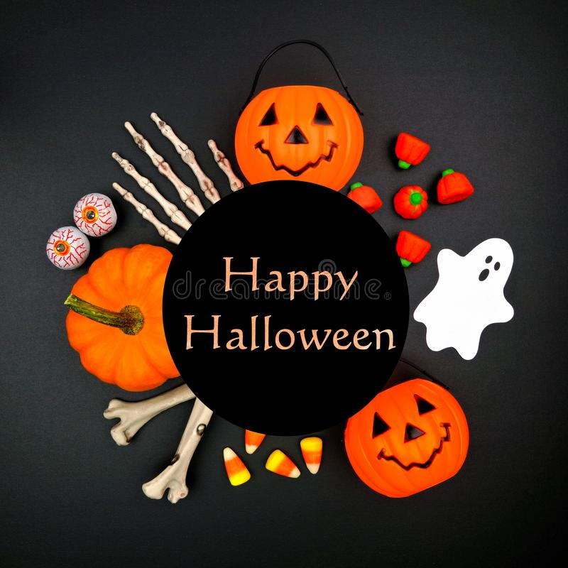 Happy Halloween greeting on black background with circle frame of decor stock photography