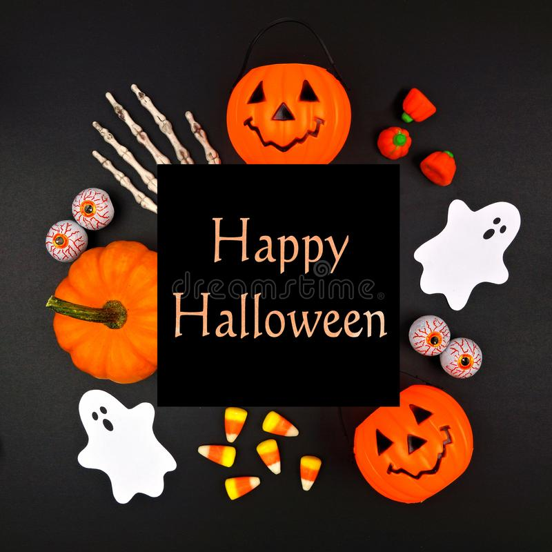 Happy Halloween greeting on black background with square frame of decor. Happy Halloween greeting on a black background with square frame of orange, black and royalty free stock photography