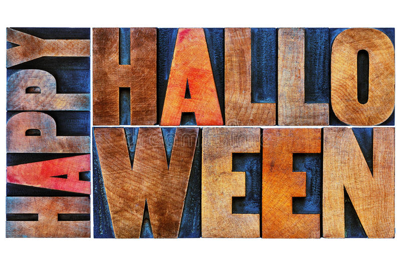 Happy Halloween greeting card. Text in vintage grunge wood type printing blocks stained by color inks stock photo