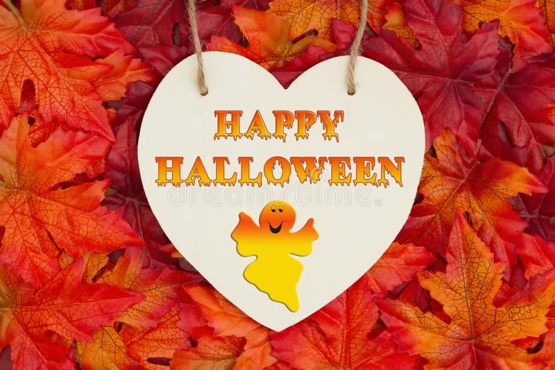 Happy Halloween greeting with fall leaves royalty free stock image