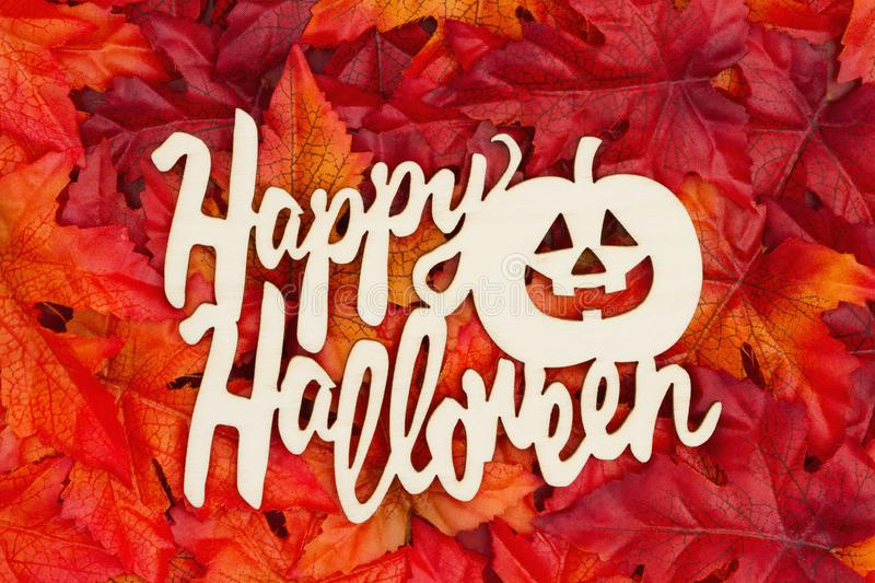 Happy Halloween greeting with fall leaves stock photos