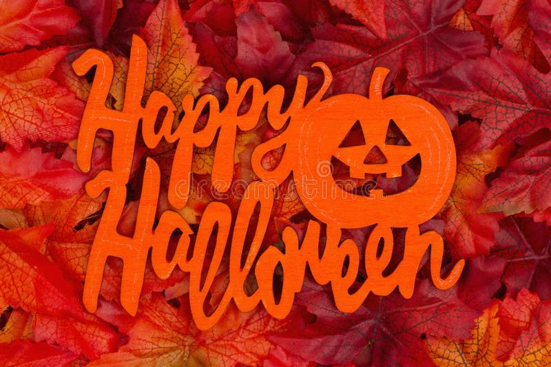 Happy Halloween greeting with fall leaves royalty free stock photography