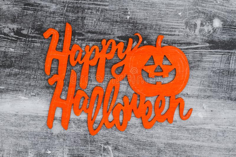 Happy Halloween greeting on a weathered wood. Happy Halloween greeting, A wood sign with text Happy Halloween and pumpkin on a weathered wood stock photos