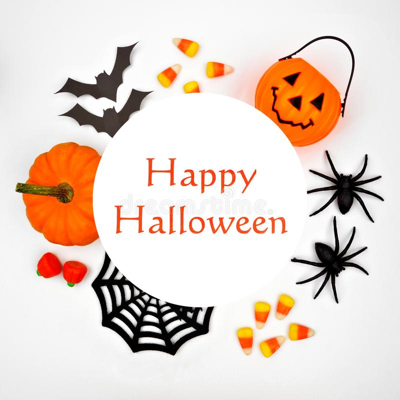 Happy Halloween greeting on a white background with circle frame of decor. Happy Halloween greeting on a white background with circle frame of orange and black stock photography